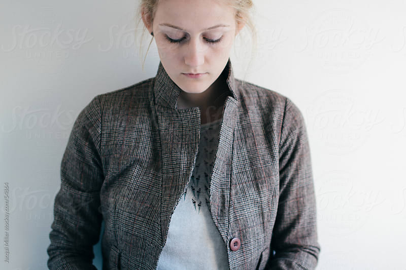Girl wearing a brown wool jacket by Jacqui Miller for Stocksy United