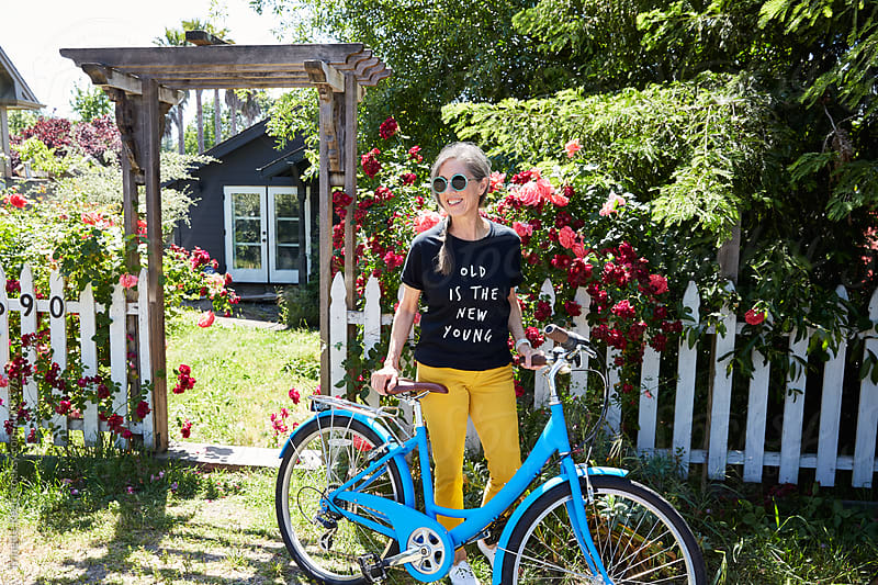 Portrait of stylish senior woman with bike by Trinette Reed for Stocksy United