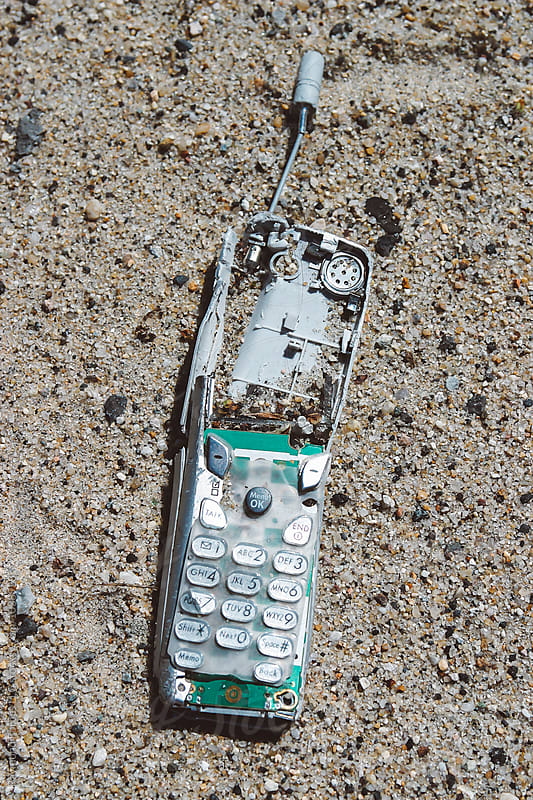 Cell Phone Fossil  by Raymond Forbes LLC for Stocksy United