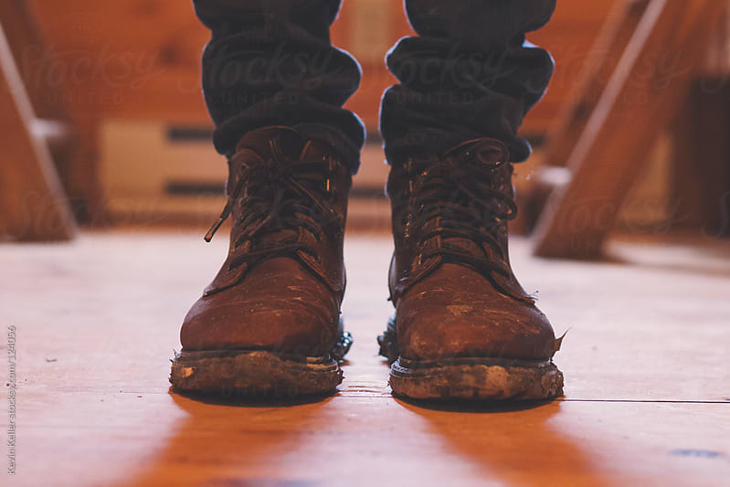 Standing in a Pair of Muddy Boots by Kevin Keller for Stocksy United