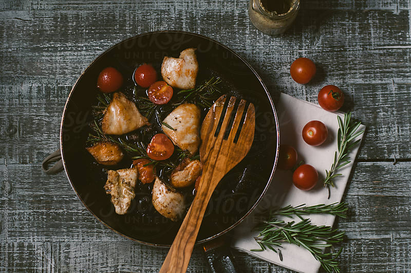 Preparing grilled chicken with vegetables by Branislav Jovanovic for Stocksy United