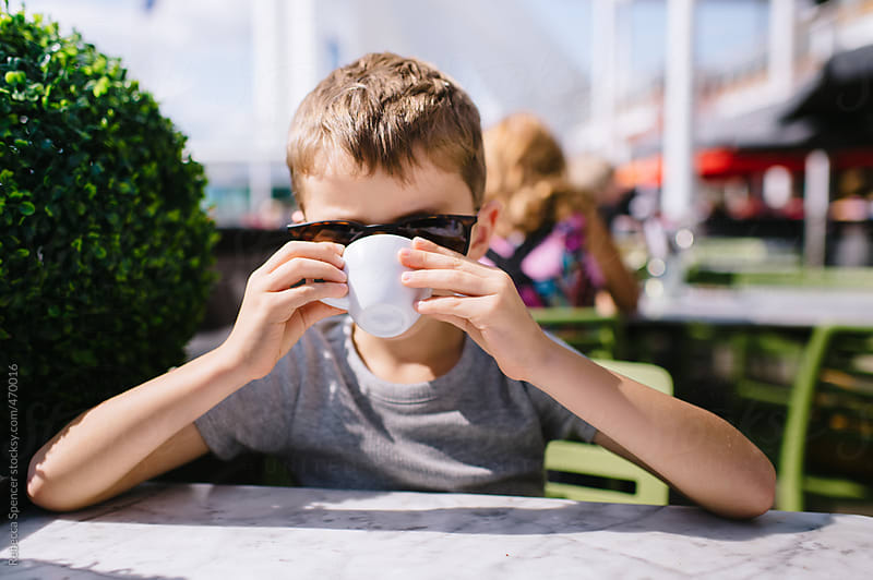 Anonymous portrait of child drinking coffee by Rebecca Spencer for Stocksy United