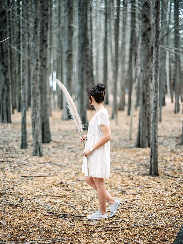 Girl walking in forest by Daniel Kim Photography for Stocksy United