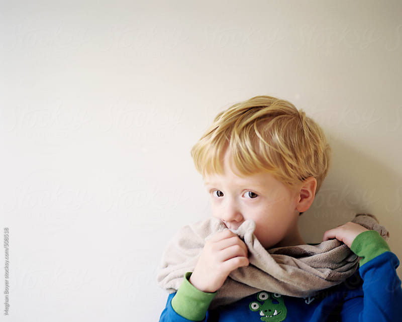 cute little boy snuggling with his blankie  by Meghan Boyer for Stocksy United