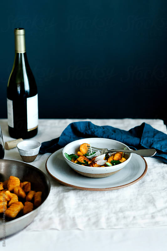 Pumpkin gnocchi served with parmesan cheese by Ellie Baygulov for Stocksy United