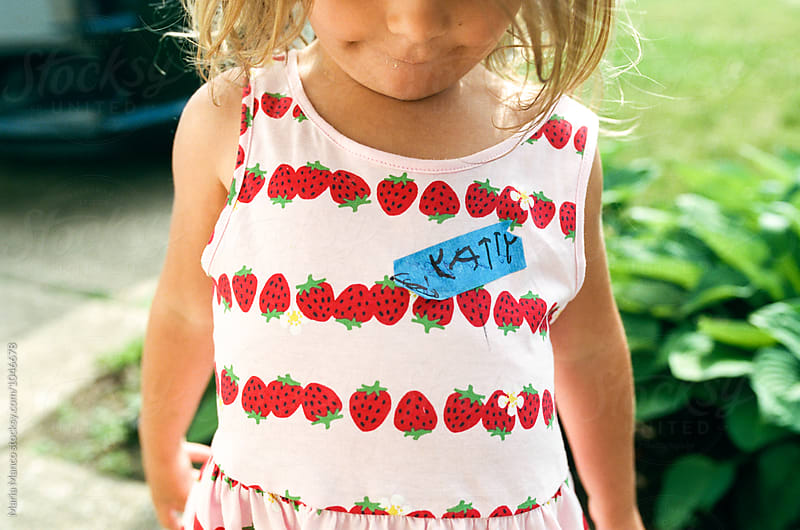 little girl with name tag in childs handwriting by Maria Manco for Stocksy United