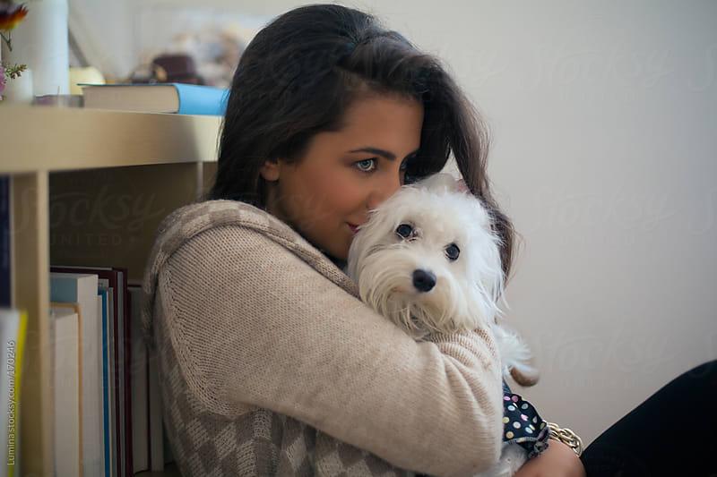 Girl Kissing Her Dog by Lumina for Stocksy United