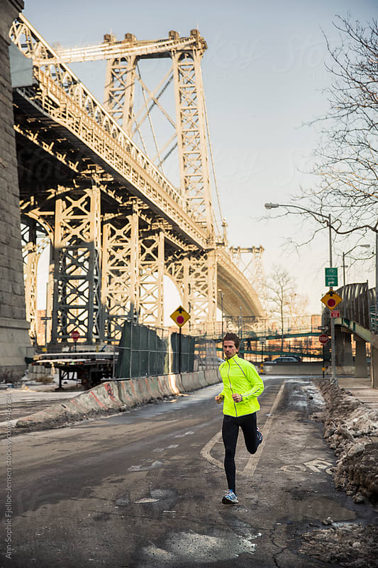 Runner running next to Manhattan Bridge by Ann-Sophie Fjelloe-Jensen for Stocksy United