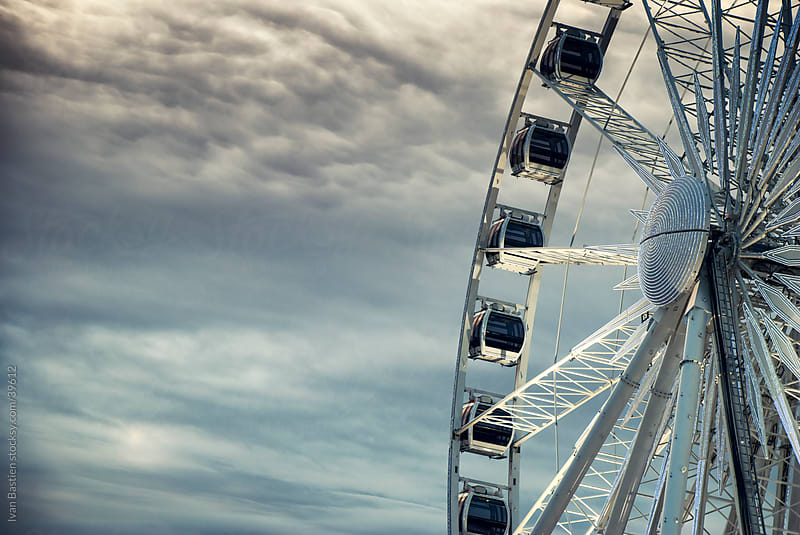 Ferris wheel and overcast sky by Ivan Bastien for Stocksy United