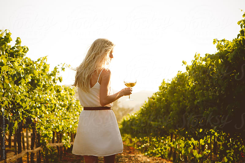 Woman in Vineyard by Jayme Burrows for Stocksy United