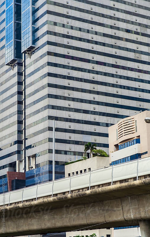 Corporative building with metro line viaduct/Bangkok  by Audrey Shtecinjo for Stocksy United