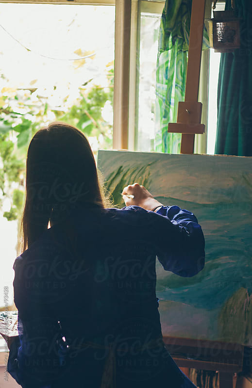 Young woman painting in her studio by Aleksandra Jankovic for Stocksy United