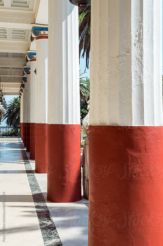 Red and white avenue of external stone pillars. by Paul Phillips for Stocksy United