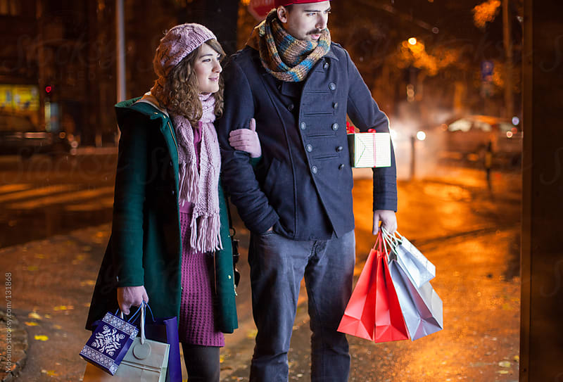 Couple in Christmas Shopping by Mosuno for Stocksy United