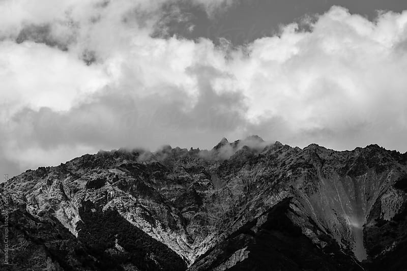 Snowy mountain peak in black and white by Leandro Crespi for Stocksy United