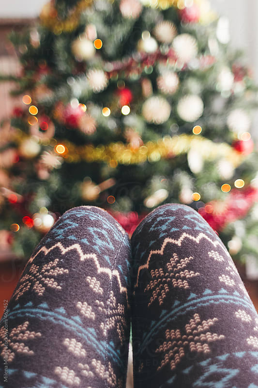 Girl's legs with Christmas leggings by Milena Milani for Stocksy United