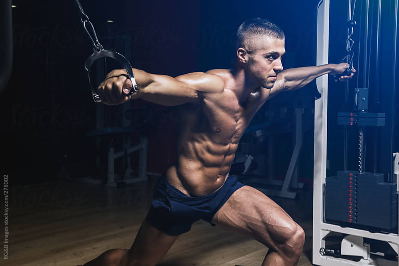 bodybuilder working out  by RG&B Images for Stocksy United