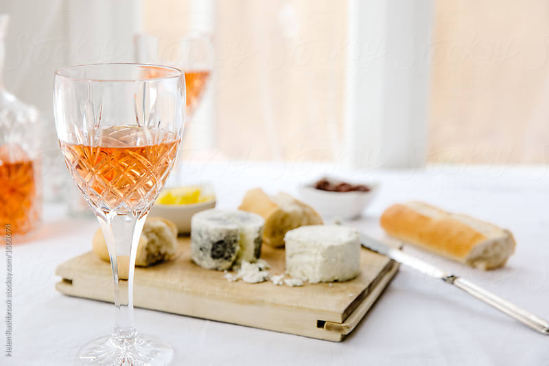 Rose wine, cheese, bread and preserved figs. by Helen Rushbrook for Stocksy United