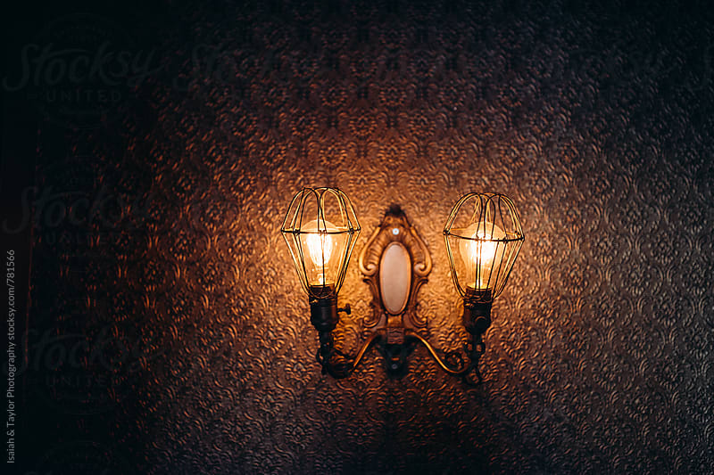 Light fixture on wall by Isaiah & Taylor Photography for Stocksy United