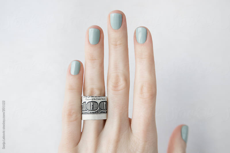 hundred dollars ring on hand by Sonja Lekovic for Stocksy United