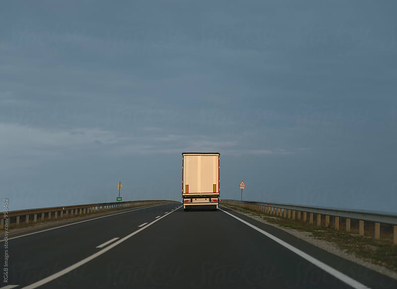 Truck on the highway in sunset light by RG&B Images for Stocksy United