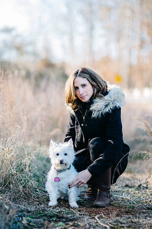 Beautiful woman with her small white dog by Jakob for Stocksy United