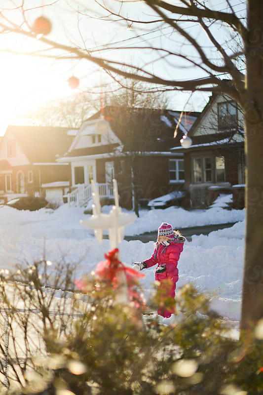 Little Girl Playing Outdoors in Winter Snow at Christmas by JP Danko for Stocksy United