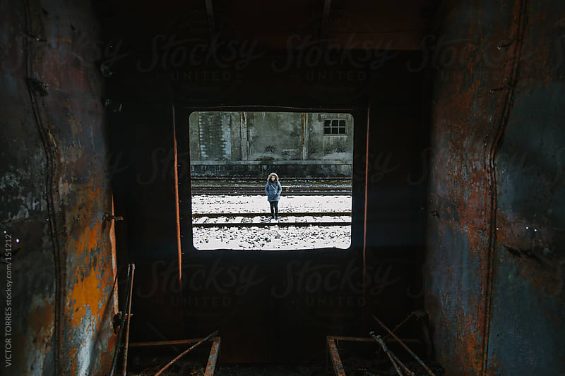 View of a Woman Through a Rusty Abandoned Train Window by VICTOR TORRES for Stocksy United