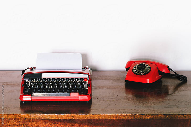 Vintage red typewriter and rotary dial phone by Pixel Stories for Stocksy United