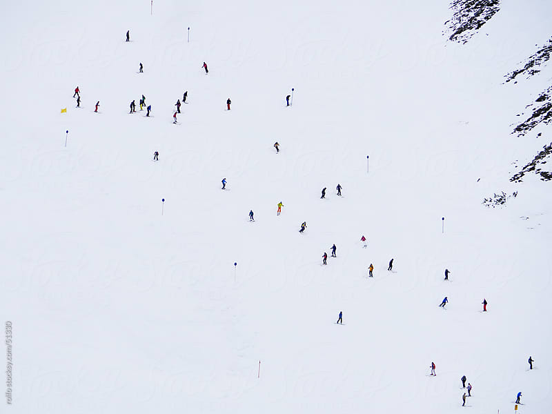 skiing snowy mountains bird's view by rolfo for Stocksy United