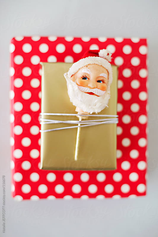 gift wrapping presents for Christmas by Natalie JEFFCOTT for Stocksy United