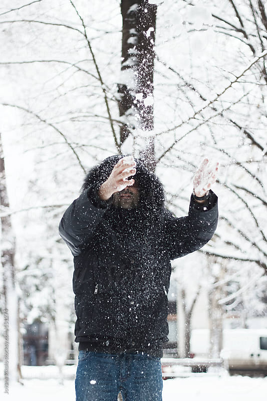 Young man throwing snow in the nature by Jovana Rikalo for Stocksy United