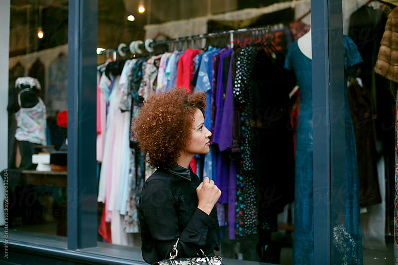 Woman window shopping by Jennifer Brister for Stocksy United