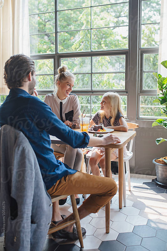 Family in a Restaurant by Lumina for Stocksy United