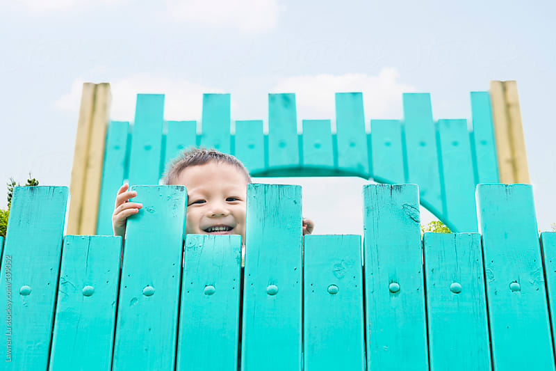 Child smile on top of wooden castle  by Lawren Lu for Stocksy United