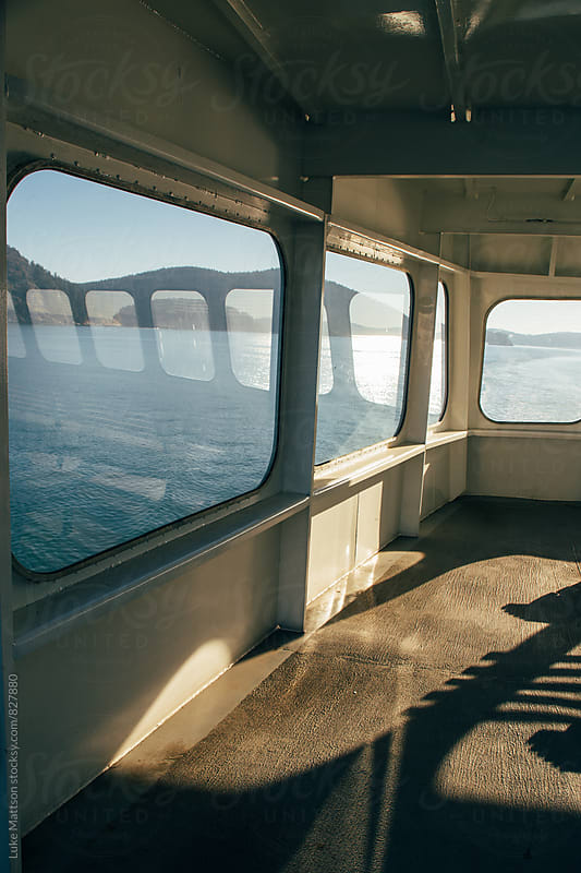 Windows Glowing With Sunlight On Upper Deck of Passenger Ferry Boat by Luke Mattson for Stocksy United