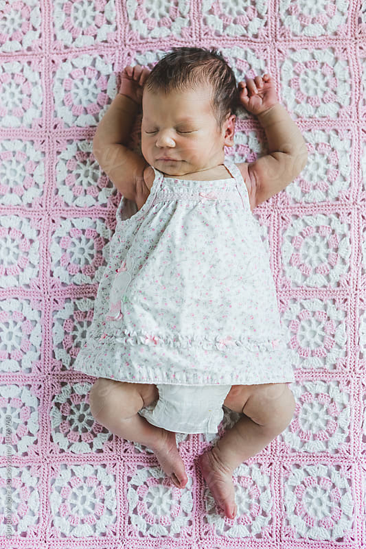 Newborn Baby Girl Sleeping on an Handmade Blanket by Giorgio Magini for Stocksy United
