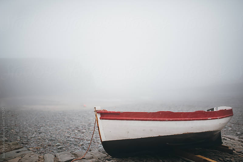Boat on a quay in fog by Suzi Marshall for Stocksy United