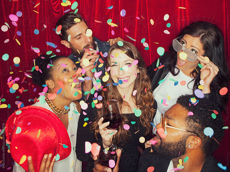 Party Guests In Photo Booth At Event by Sean Locke for Stocksy United