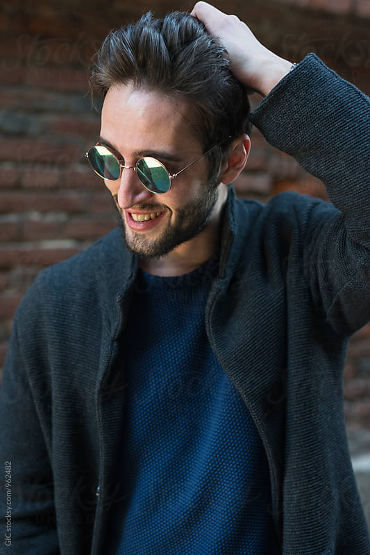 Smiling man with sunglasses portrait by WAVE for Stocksy United