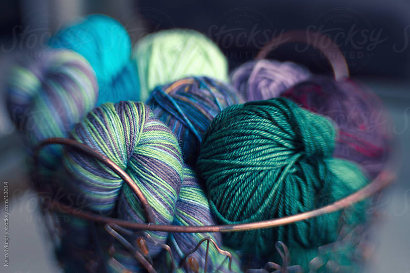 Basket of colorful yarn fiber by Kerry Murphy for Stocksy United