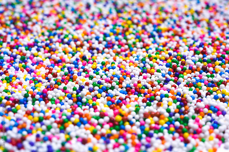 Close up of colorful sprinkles by Luca Pierro for Stocksy United