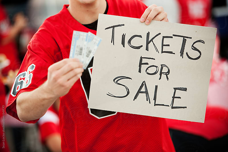 Tailgating: Selling Tickets Outside Stadium by Sean Locke for Stocksy United