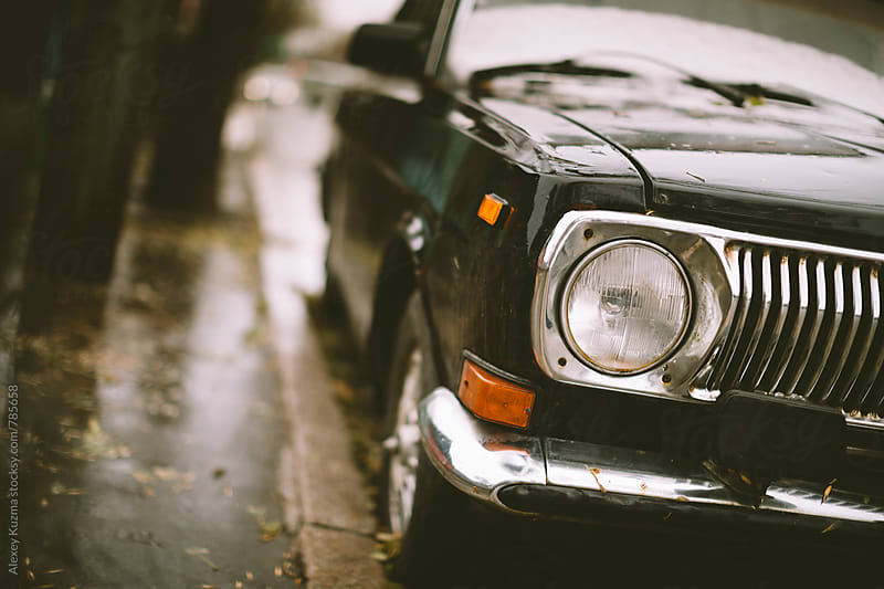 wet black classic vintage car  by Alexey Kuzma for Stocksy United