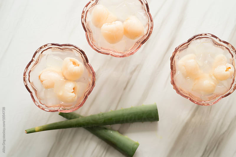 Aloe vera cubes with lychees by Alita Ong for Stocksy United