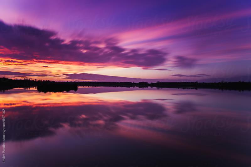 Sunset on Estany d'Ivars, Lleida. by Javier Pardina for Stocksy United
