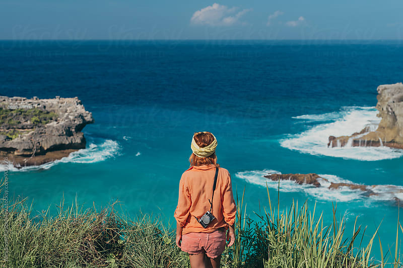 Tourist  On A Edge Of Cliff At  Tropical Ocean by Alexander Grabchilev for Stocksy United