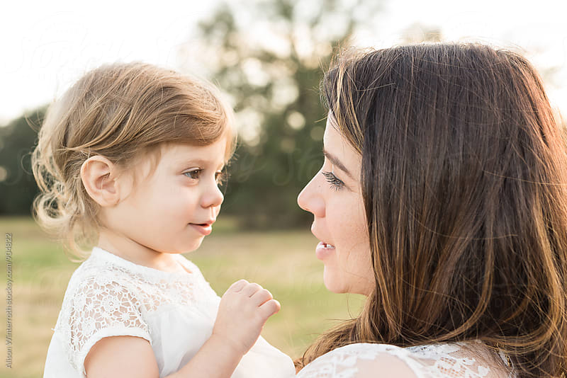 A Little Girl Looking At Her Mother by Alison Winterroth for Stocksy United