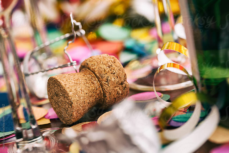 Champagne: Cork From Bottle Of Champagne Sits In Confetti by Sean Locke for Stocksy United
