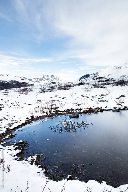 Frozen pool in Iceland by Ruth Black for Stocksy United